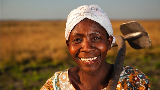 Zambian Woman With Hoe